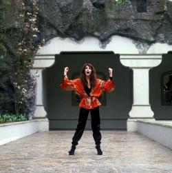 Kate Bush before the entrance of the cave which is part of the Indian Waterlillies