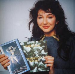 Kate Bush showing the Single File box set and video